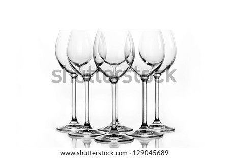Group of empty wine glass. Isolated on a white background. Black and white image. - stock photo