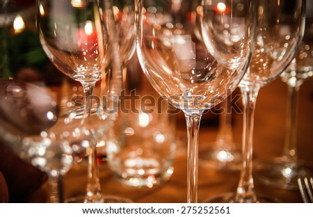 group of empty wine glasses on the table - stock photo