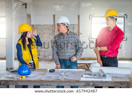 Group engineer checking blueprint on table stock photo 657942487 group of engineer checking the blueprint on the table and talking about construction project with commitment malvernweather Gallery