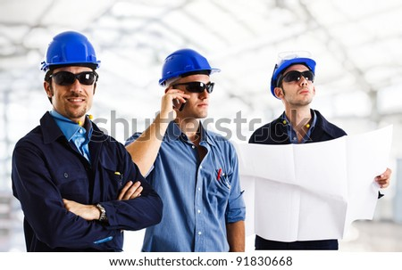 Group of engineers at work - stock photo