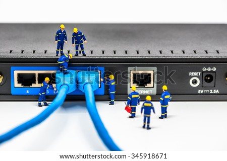 Group of engineers connecting fiber network cables. Macro photo - stock photo