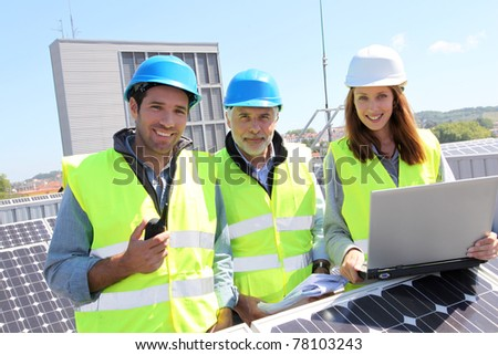 Group of engineers meeting on building roof - stock photo