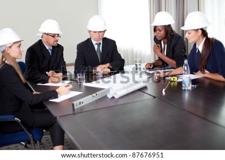 Group of engineers working together on a new project at the office - stock photo