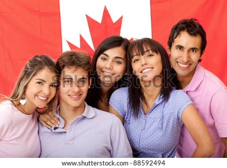 Group of English or French students with the flag of Canada - stock photo