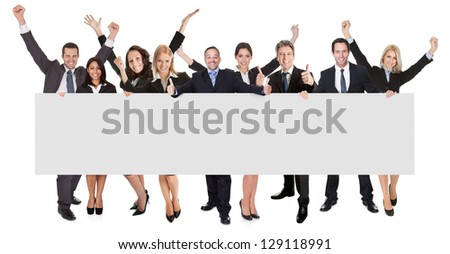Group of excited business people presenting empty banner. Isolated on white - stock photo