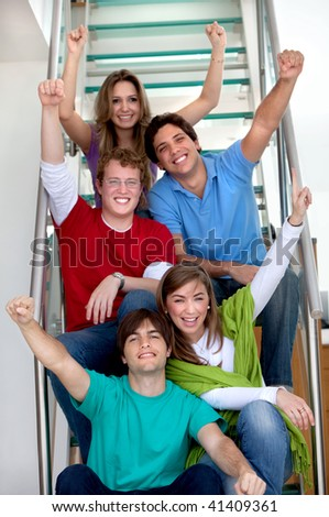 group of excited friends smiling at home