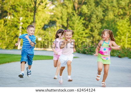 Group of excited preschoolers running - stock photo