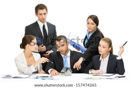 Group of executives debating while sitting at the table, isolated. Concept of teamwork and cooperation