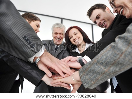 Group of executives placing their hands together - stock photo