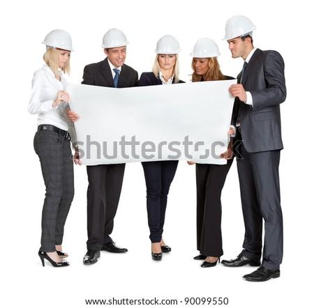 Group of experienced architects studying blueprints on white background - stock photo