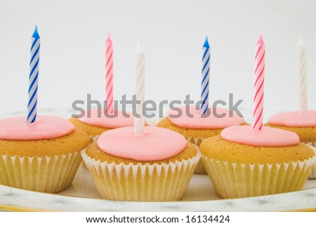 Group of fairy cup cakes with candles