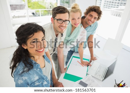 Group of fashion designers discussing designs in a studio - stock photo
