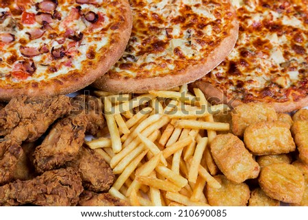 group of fastfood - chicken nuggets, legs, pizzas and fry potatos - stock photo