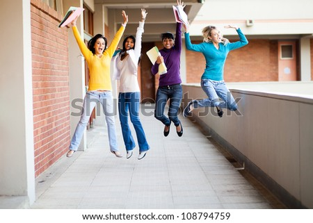 group of female college students jumping up - stock photo