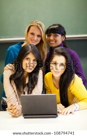 group of female college students with laptop - stock photo