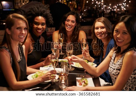 Group Of Female Friends Enjoying Meal In Restaurant - stock photo