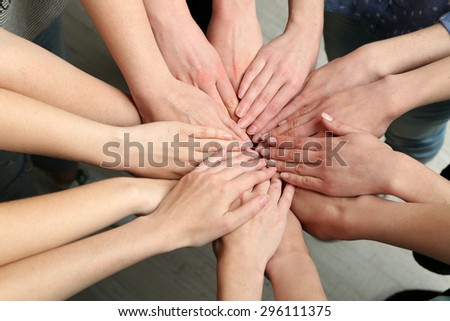Group of female hands together, closeup