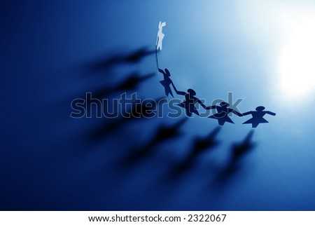 Group of female paper chain representing teamwork. - stock photo