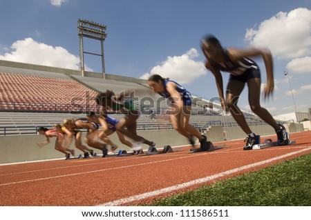 Group of female runners starting race - stock photo