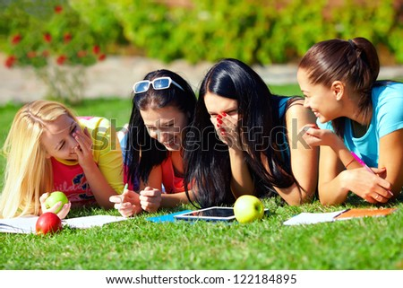 group of female students having fun on green field - stock photo