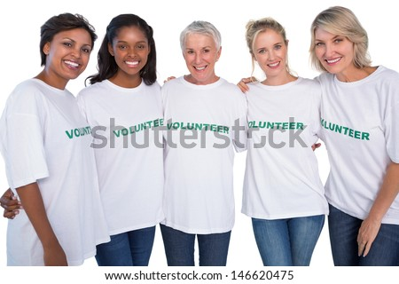 Group of female volunteers smiling at camera on white background - stock photo