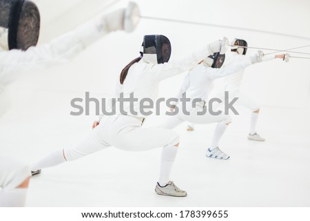 Group of fencing professionals in a training session. - stock photo
