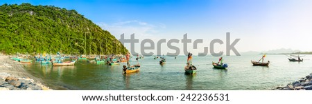 group of fishing boat anchored at Pranburi beach in Thailand, panorama - stock photo
