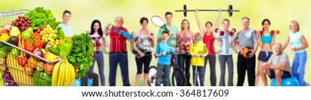 Group of fitness people with food. - stock photo