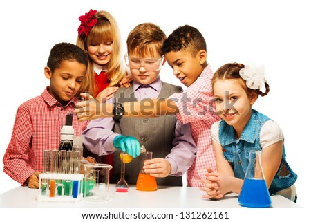 Group of five diversity kids boys and girls blond and brunet with microscope and test tubes and flasks in chemistry class, isolated on white - stock photo