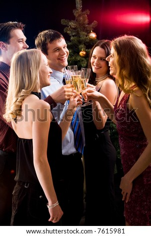 Group of five friends clinking  glasses with each other at christmas - stock photo