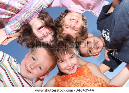 Group of Five Friends Outdoors Looking Down Smiling - stock photo