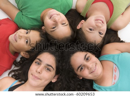 group of five girls heads together isolated on white.