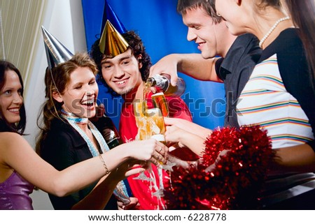 Group of five happy friends at a party - stock photo