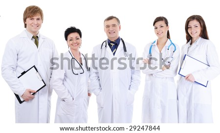 group of five laughing successful doctors standing together and looking at camera - stock photo