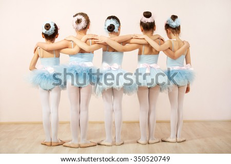 Group of five little ballerinas posing together with back to camera. They are good friend and amazing dance performers - stock photo