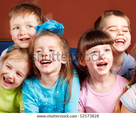 Group of five preschool kids laughing - stock photo