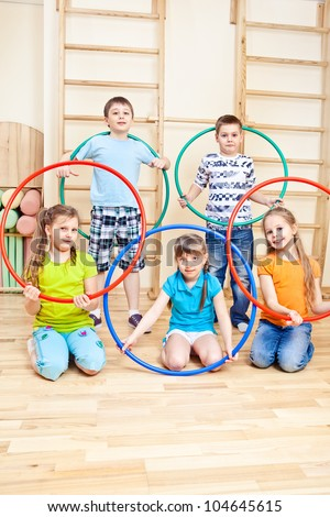 Group of five primary school students in gym - stock photo