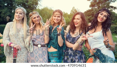 Group of five young women dress to wear Boho style.