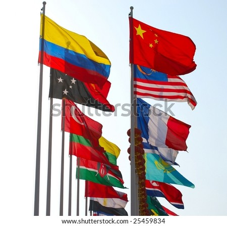 Group of flags against blue sky. - stock photo