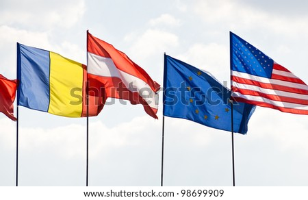 Group of flags against blue sky - stock photo