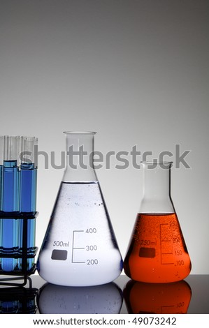 group of flasks and test tubes with colored liquid