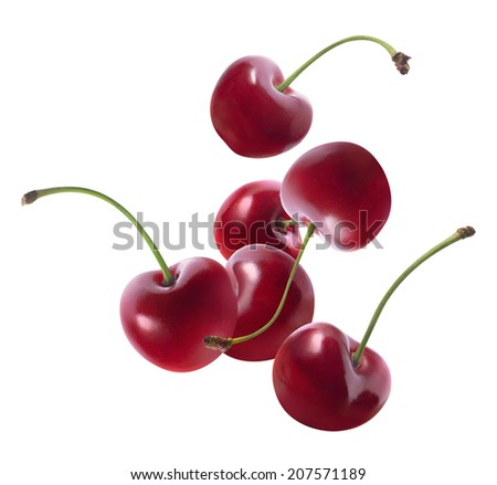 Group of flying cherries isolated on white background as package design elements - stock photo