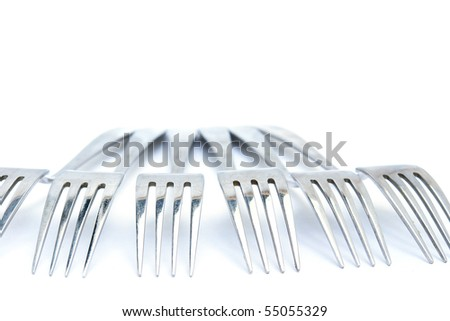 Group of Forks from the aged metal. Isolated on white - stock photo