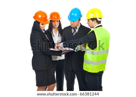 Group of four architects with hard hats  having conversation and holding blueprints isolated on white background