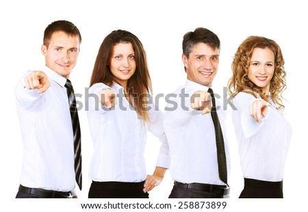 Group of four business people in a row pointing - stock photo