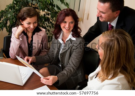 Group of four business people working at meeting - stock photo