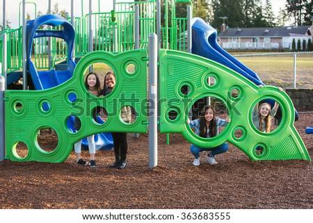 Group of four children with cultural diversity playing together  - stock photo