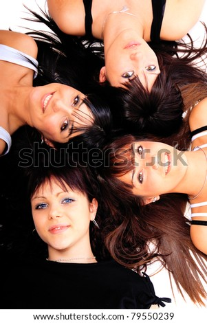Group of four girls laying on the floor - stock photo