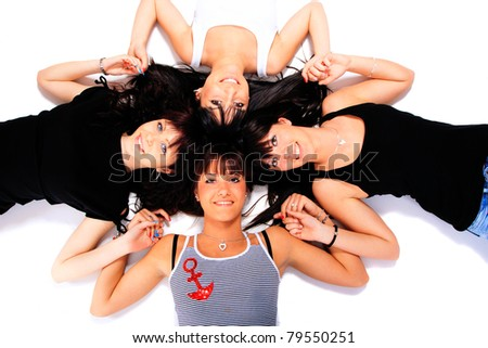 Group of four girls laying on the floor