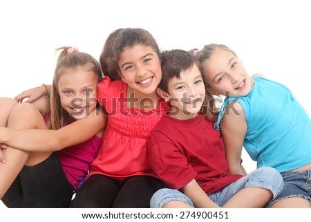 group of four happy kids on a white background - stock photo